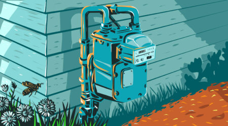 Un medidor de gas en el costado de una casa.
