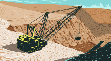 An excavating machine sits next to an open pit mine