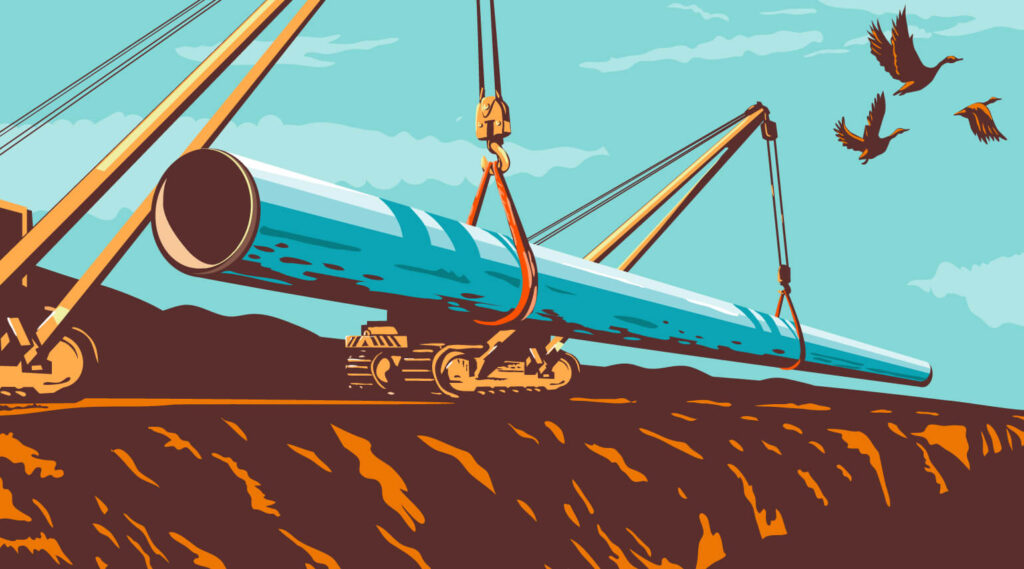Heavy machinery lays a new section of pipeline
